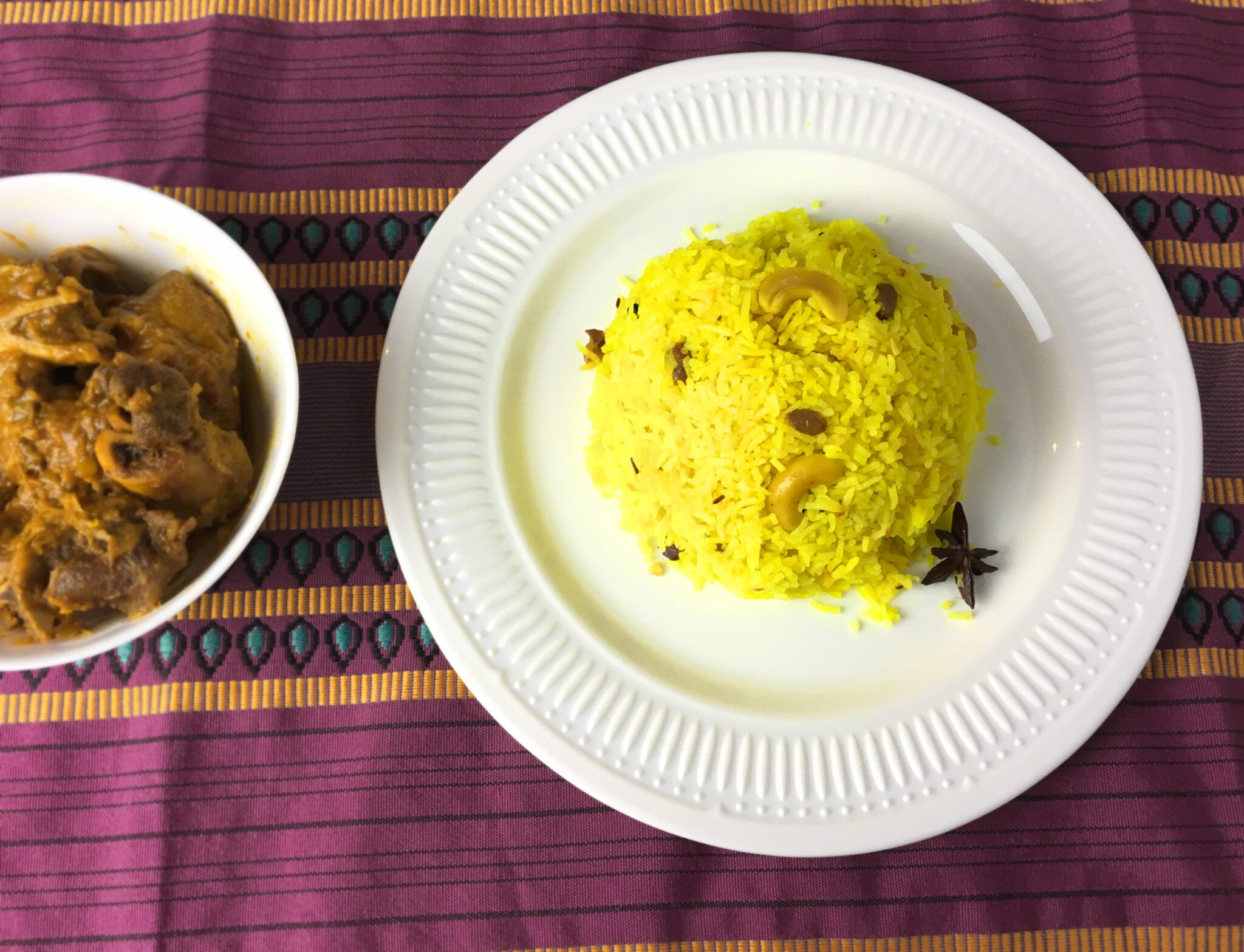 Sweet pulao served with mutton curry