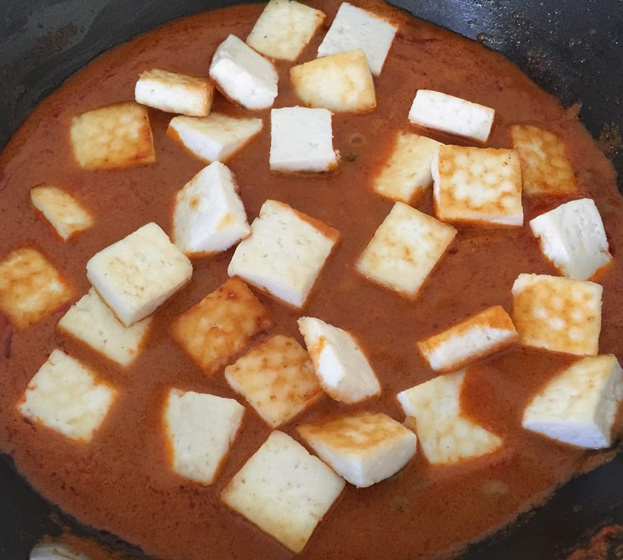 Add paneer and simmer