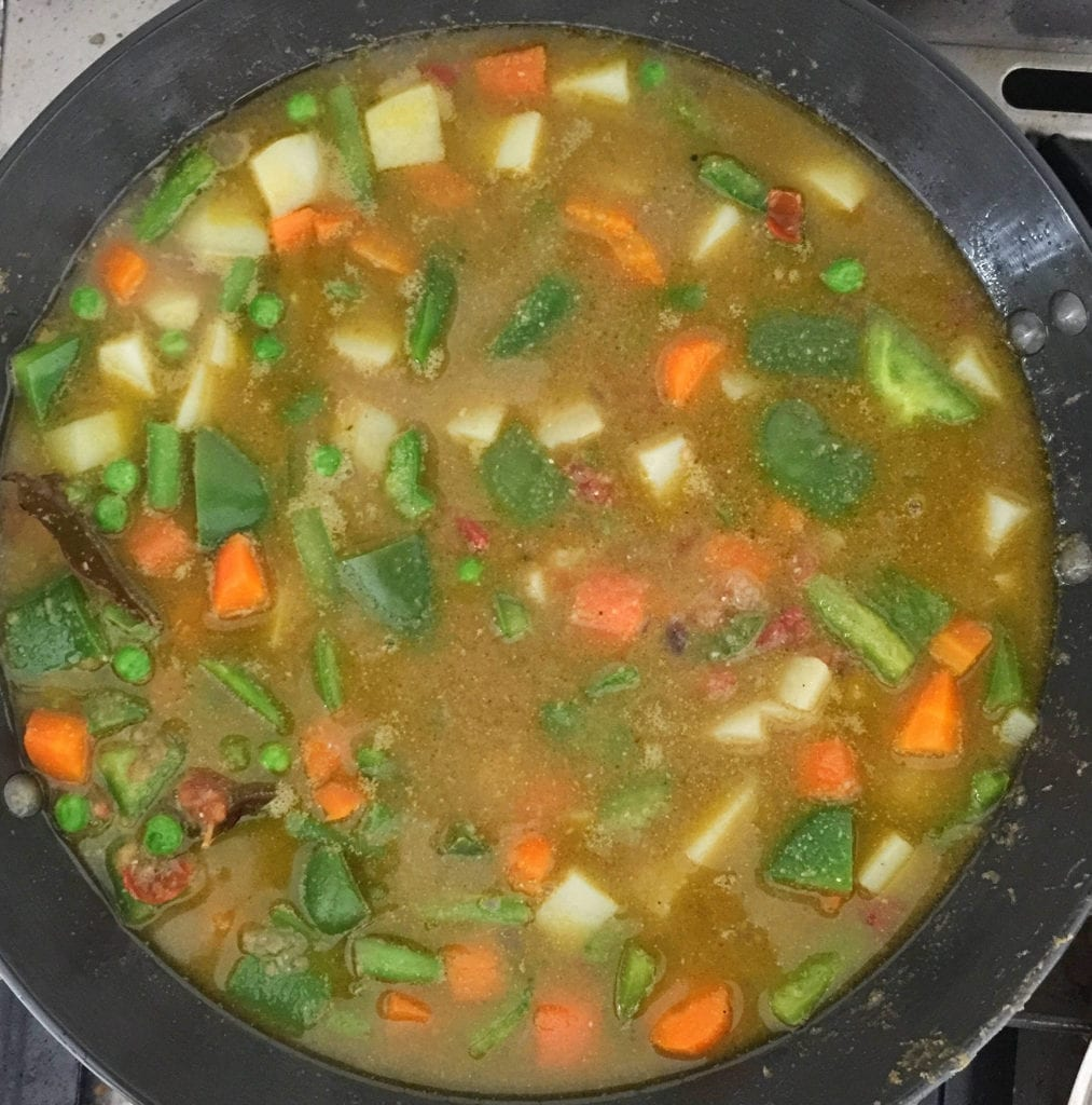 Add vegetables and water, and simmer