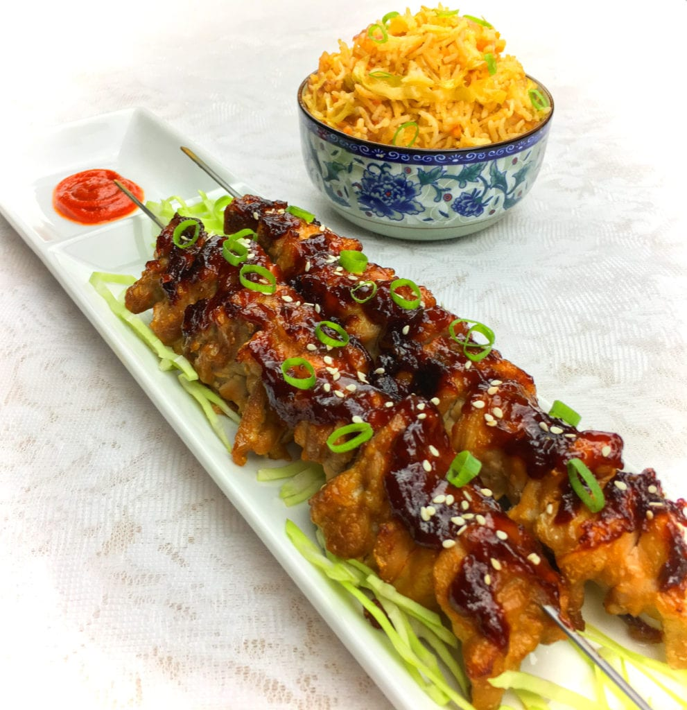 Teriyaki chicken served with Chinese fried rice
