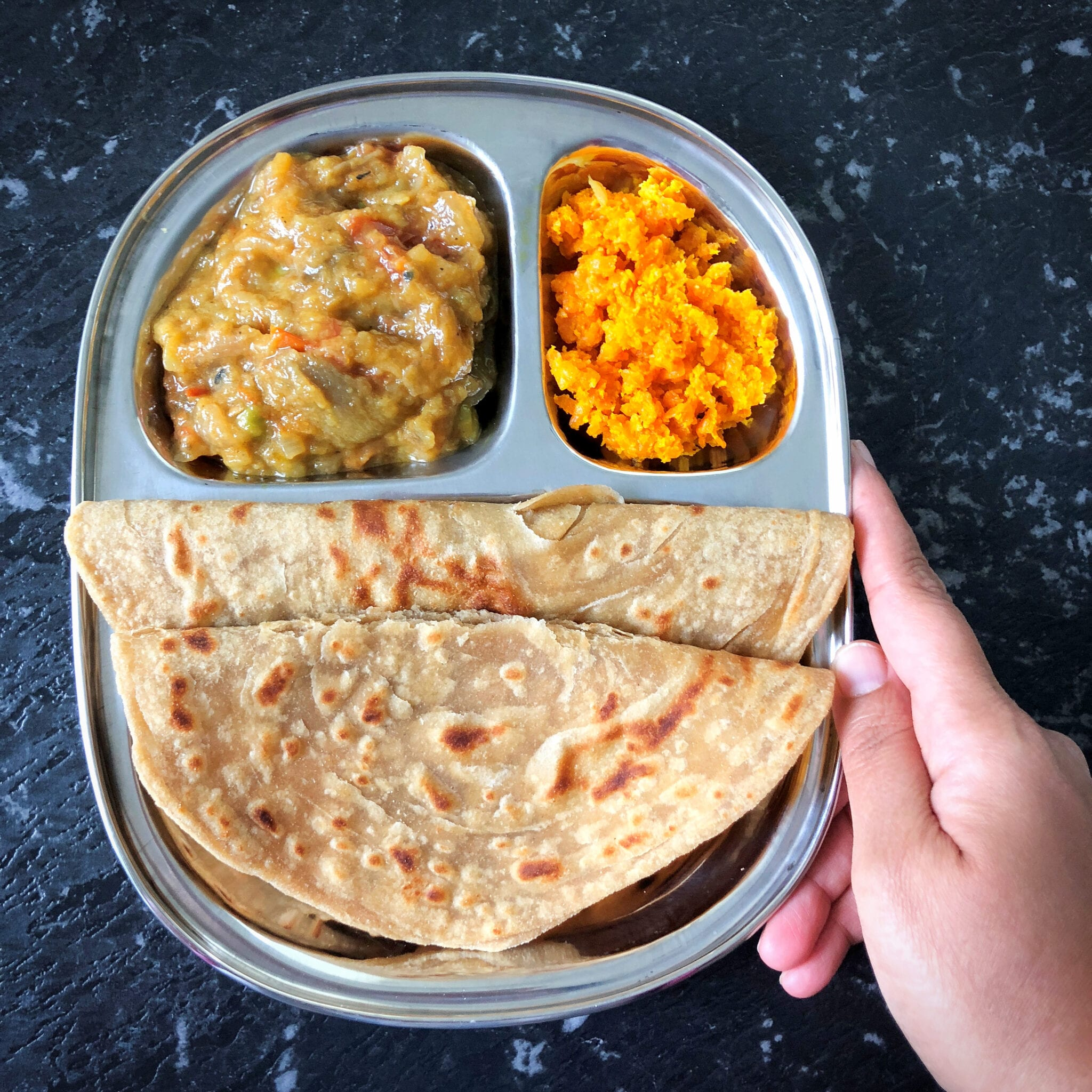 Lachha Paratha served with baingan bharta (eggplant roast) and carrot halwa for a completel meal